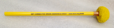 "Record Number: 082 Collection Date: 23 Nov 2017  Description: Pencil and eraser, yellow with ""Get Connected"" Brain Awareness Week logo Dimension: 8"" x 1.25"" x 1.25"""
