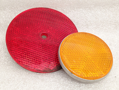 "Record Number: 091 Collection Date: 30 Nov 2017  Description: Reflectors, bright red and orange Dimension: 3"" x 1/8"", 2.25"" x .50"""