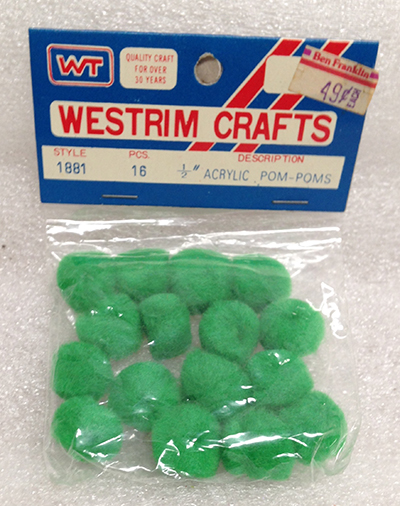"Record Number: 093 Collection Date: 30 Nov 2017  Description: Pom poms, bright green balls Dimension: 4"" x 3"" x .5"""