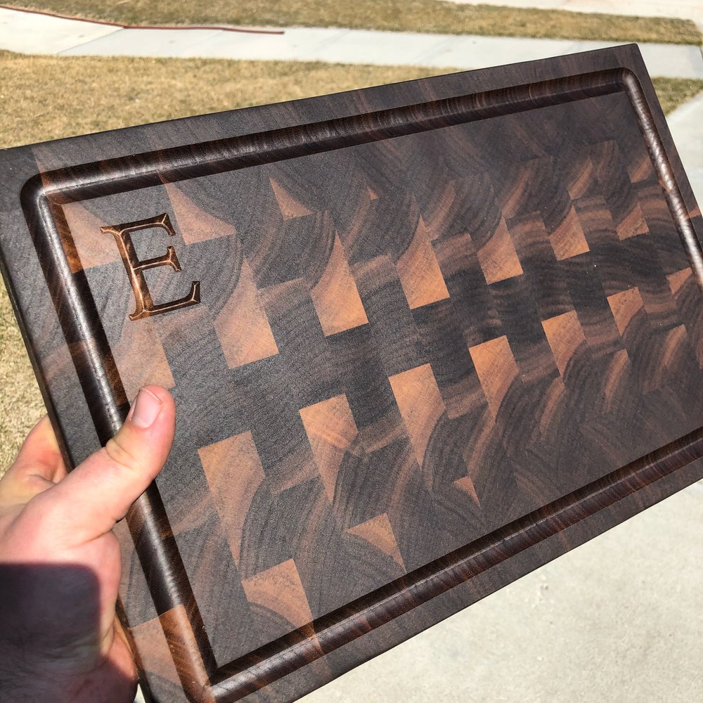 End-grain walnut cutting board with juice groove and monogram
