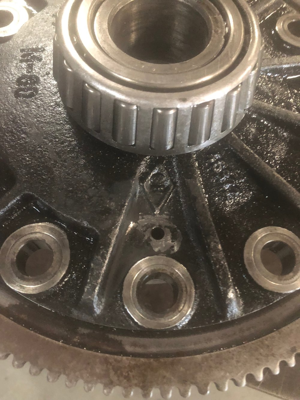Roll Pin hole that had to be de-burred and machined to relieve now Mushroomed Roll Pin.