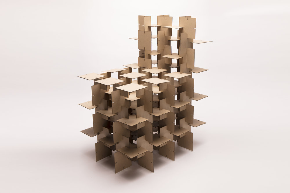1:1 Studies - On a 1:1 scale, specific materials were chosen for prototyping. Thin cardboard was used to test module size and a full-scale model of the chair for physical dimensions and size. Various joints and tolerance studies were done to make sure the chair can be assembled without the use of glue. The simple nature of the module allowed for an in-depth material and color study, exploring the changes in design language based on the same form.