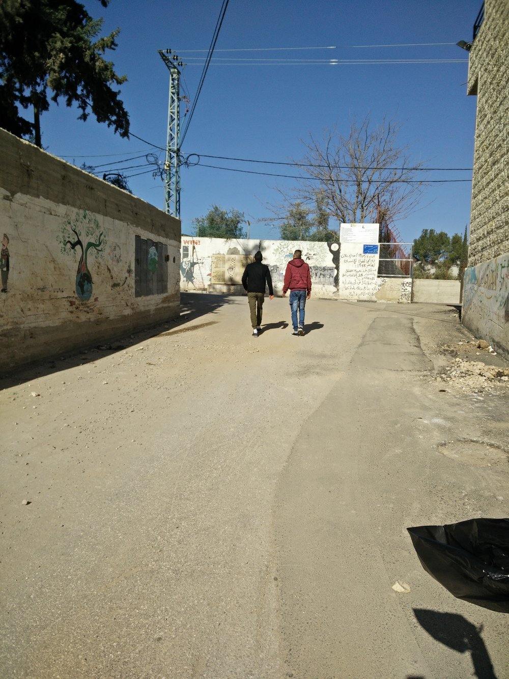 Two boys walking on the streets of Aida Camp.