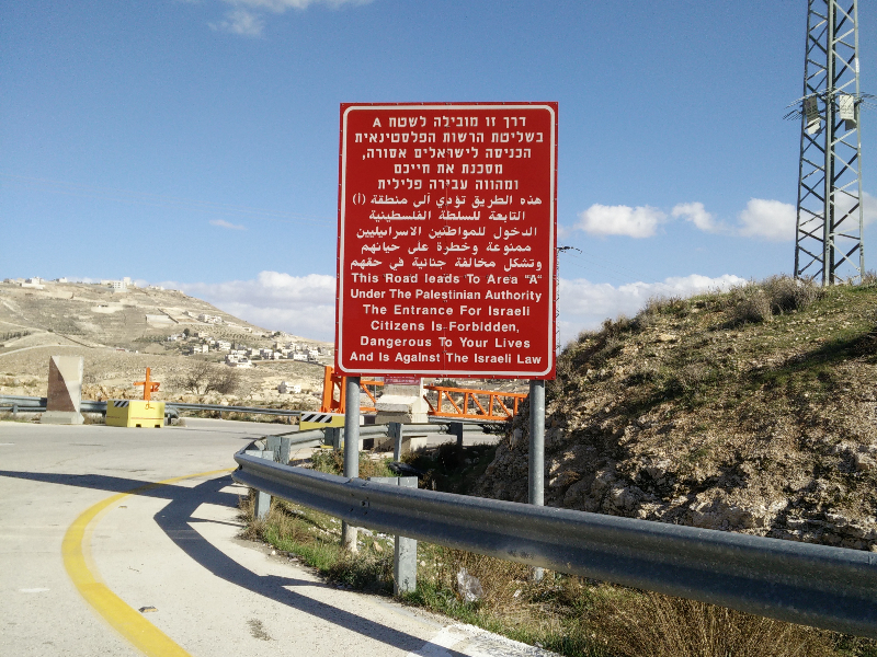 These signs are placed next to the highways. These highways are used by Palestinians as well as Israelis; however, some areas are forbidden for Israelis to enter.