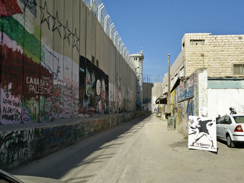 The wall was constructed to prevent Palestinians from crossing the border. Unfortunately it is built on Palestinian land, and much of it is being annexed by Israel.