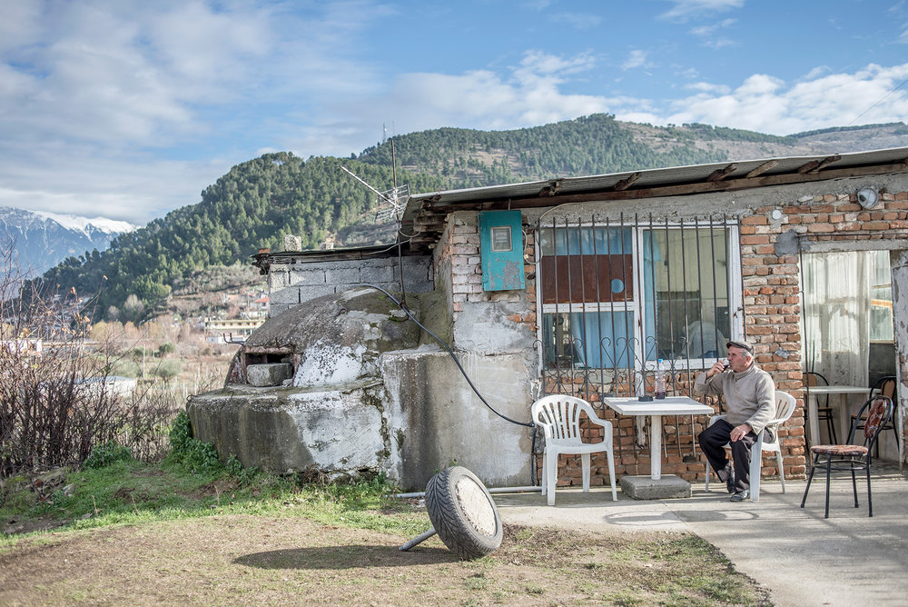 The owner of the cafe drinks wine in the backyard of his cafe, Berat - Albania
