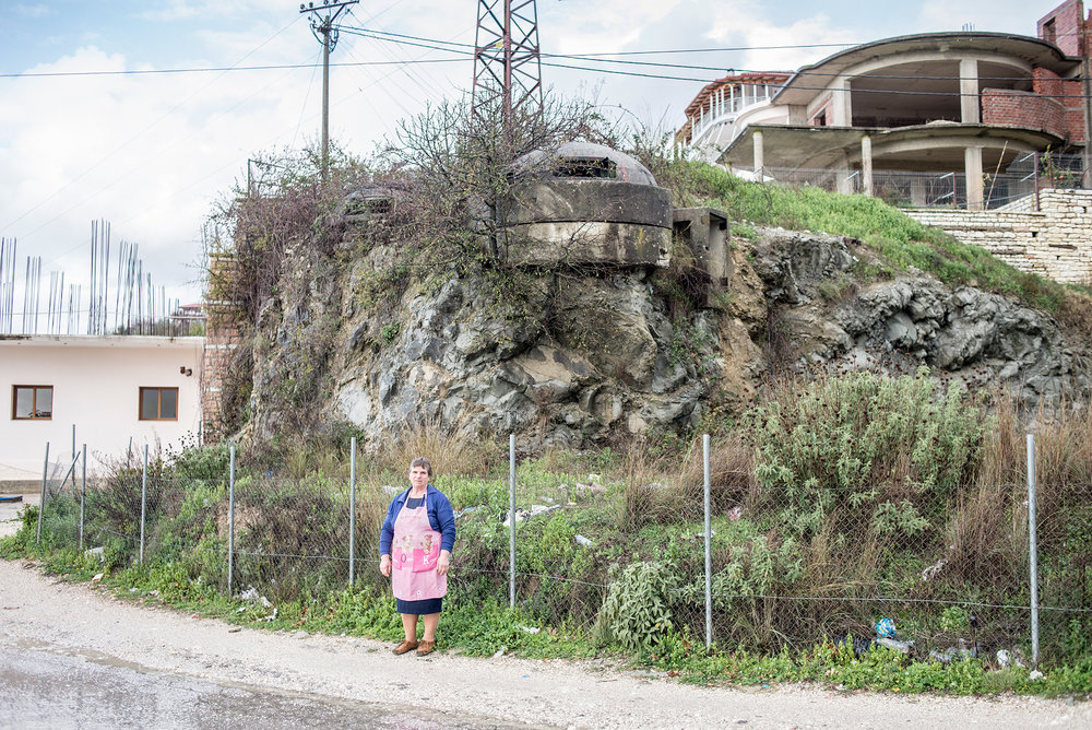 Shopkeeper stands under the bunker, Mesopotam, Albania