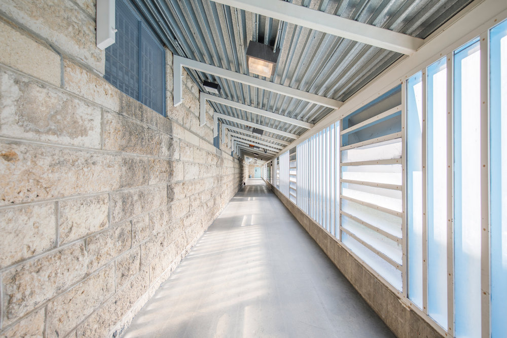 This passageway reflects the patterns of the historic buildings while providing pleasant, secure circulation.