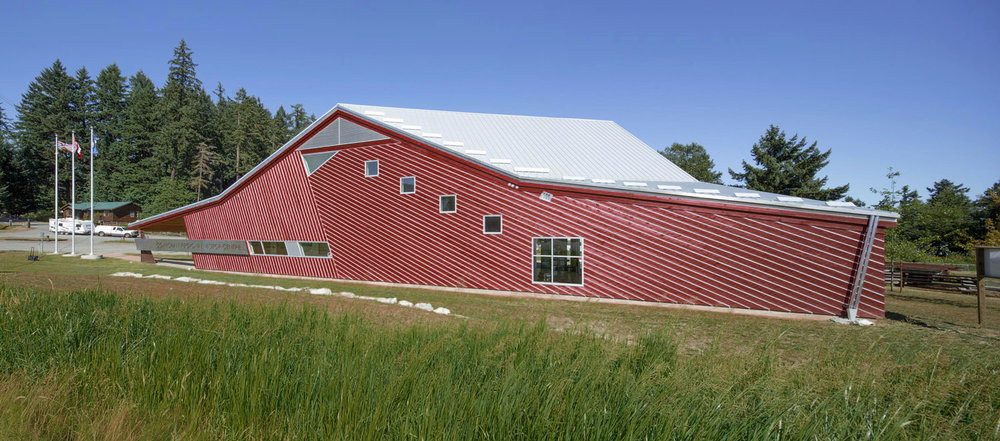 The building is constructed with locally harvested cedar, reflecting the tradition of batten siding seen on local barns. However, the battens are reversed and lined with galvalume flashing to reduce rainwater intrusion and to create a strong architectural statement.