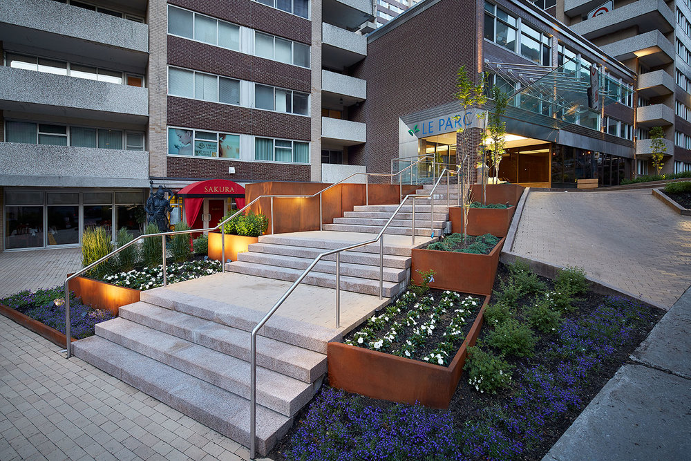 Collaboration with the landscape architect led to this gracious landscaped entry. The team's objective was to transform the steeply sloped areas surrounding the entry into a pedestrian-friendly, visually attractive space.