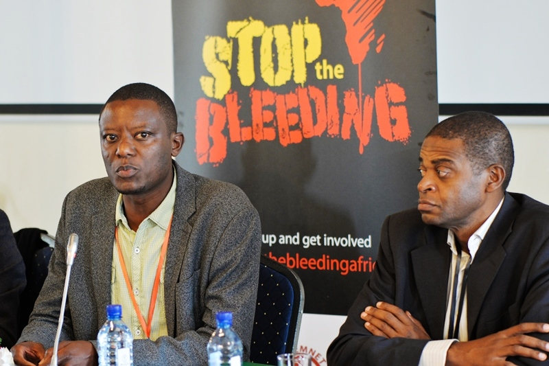 Tax Justice Network Africa (TJNA) Executive Director Alvin Mosioma and a colleague during a past event. PHOTO/COURTESY