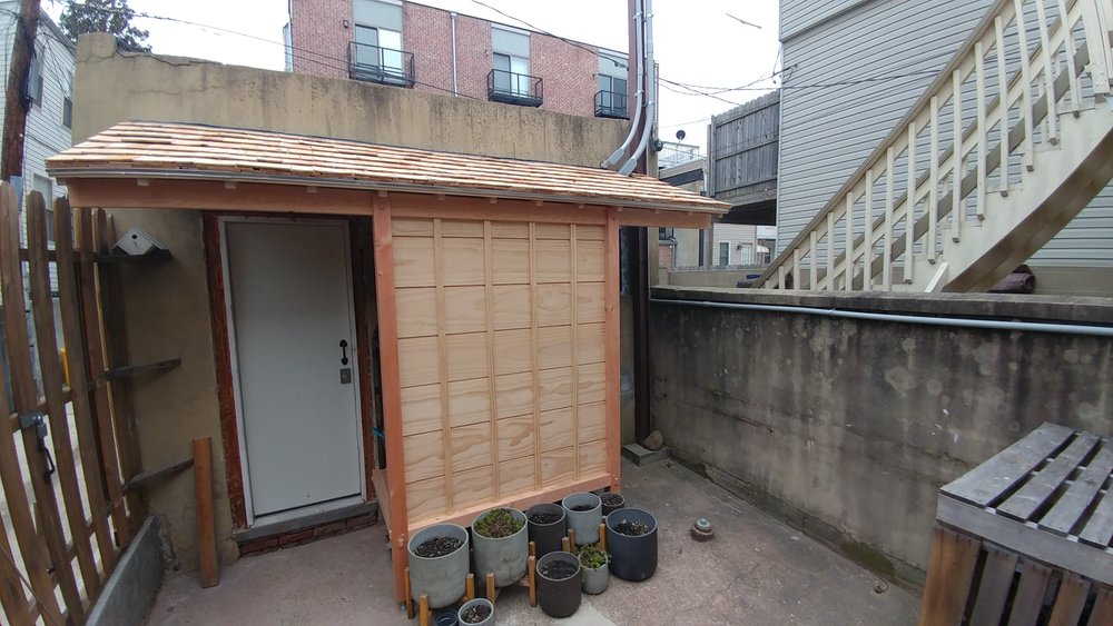 Inspired by Japanese design, this lean-to shed povides some cover to the entrance and extra storage.
