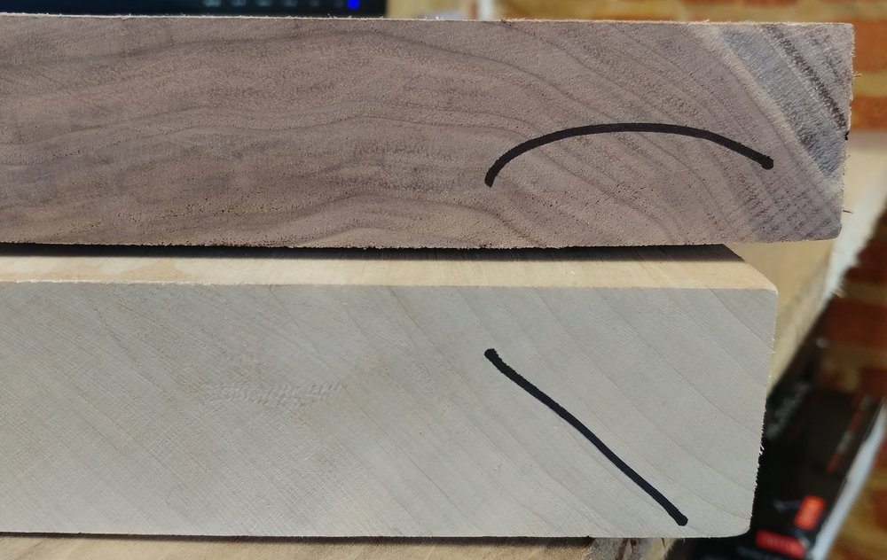 From across the shop it will be easy to see that one board is flat-sawn, and the other rift/quarter. With roughly cut boards, the saw patterns can confuse the grain under end sealant and age. These marks make it quick.