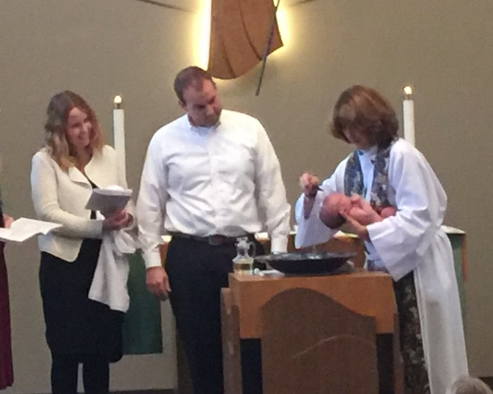 Pastor Debbie Boyce baptizes an infant at Shepherd of the Hills Lutheran Church in Sammamish, WA.