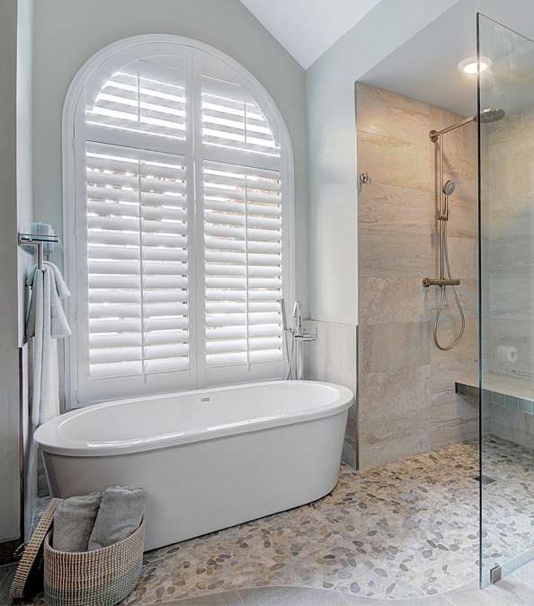 modern bathroom with walk in shower and stand alone tub