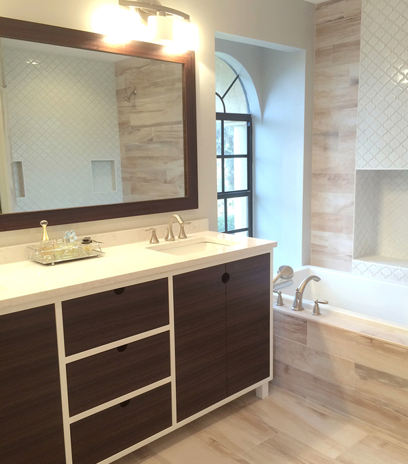 bright modern bathroom featuring dark wood vanity