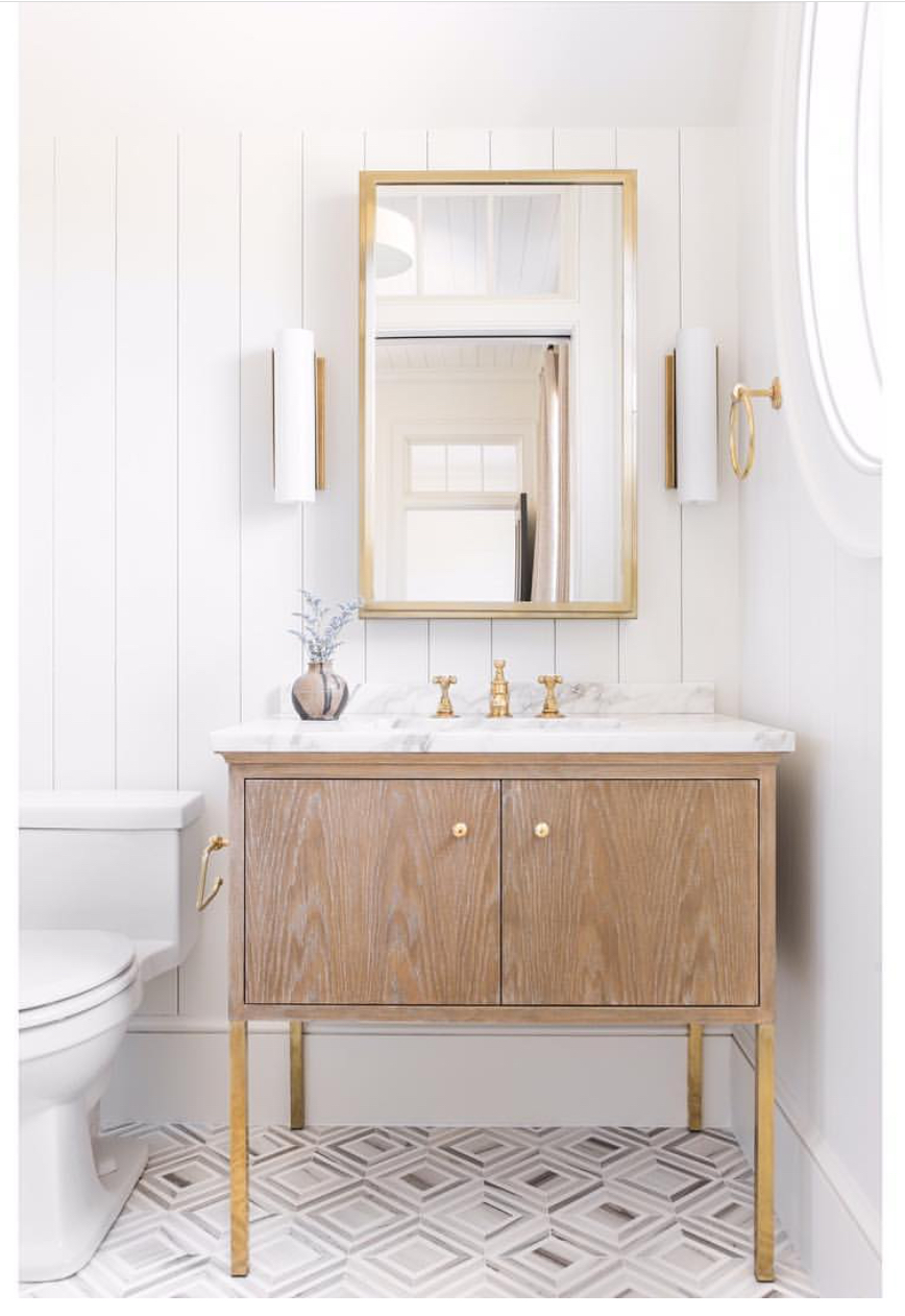 This sweet little vanity by  Cortney Bishop Design  is a great example of using tip 1 and 2. Legs and a little breather space make this bathroom all that much sweeter.
