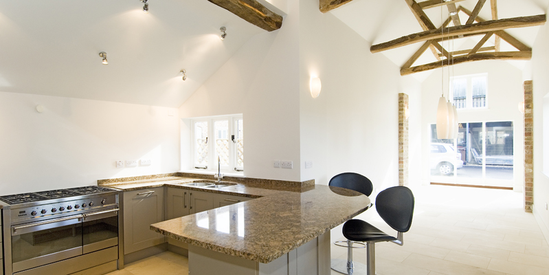Kitchen with double height ceiling in South Barn, Tredington, Gloucestershire