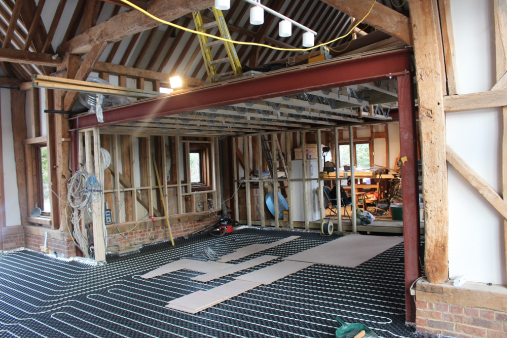 Manor Barn, Didcot, Oxfordshire redesign of internal spaces. Here installation of underfloor heating on the ground floor.