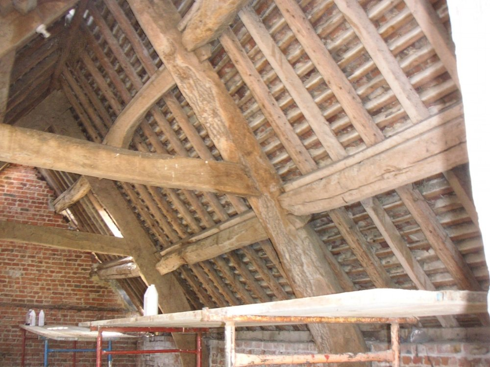 Restoration of old roof beams in barn conversion, Gloucestershire