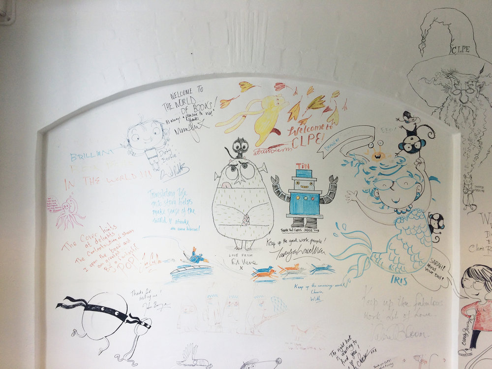 Original wall of illustrators drawings