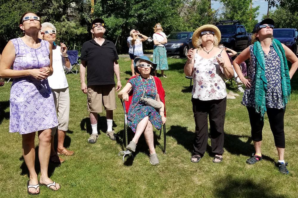 Parishioners, University of Colorado students, and neighbors gathered at St. Aidan's Episcopal Church in Boulder for an eclipse party on their green. Photos courtesy Beth McKnight
