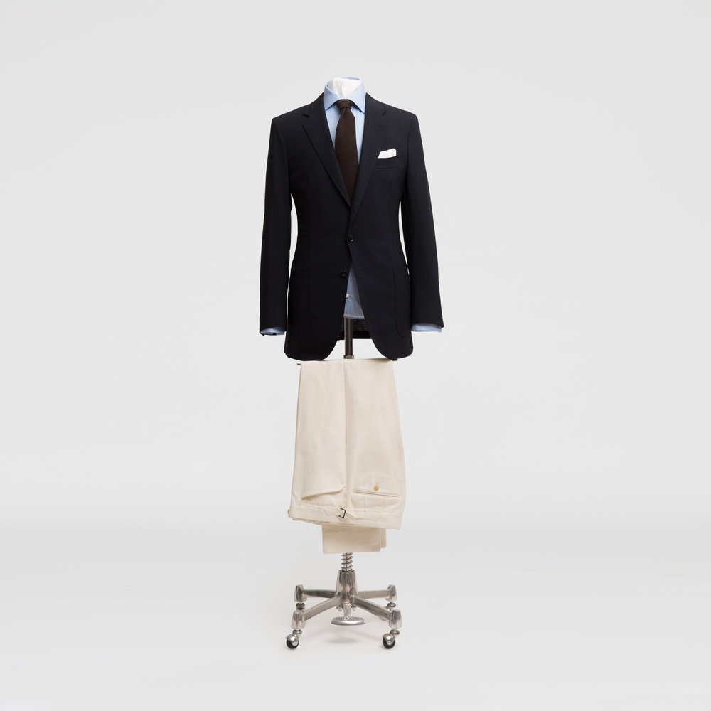 For a more casual office, pair your navy jacket with heavier drill cotton off white trousers, a brighter shirt and a soft cashmere tie.