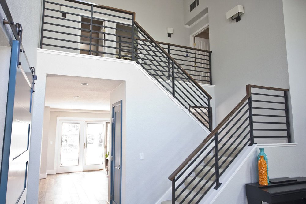 New stairway: modern horizontal railing, stained wood bannister.