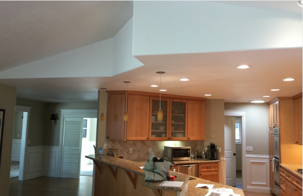 BEFORE: DROPPED CEILING WITH INADEQUATE LIGHTING AND NUMEROUS BLACK SPOTS