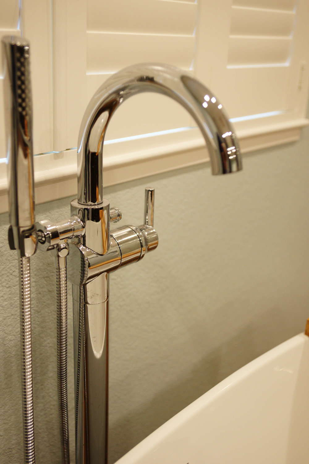 Design detail: Freestanding tub faucet with hand shower.