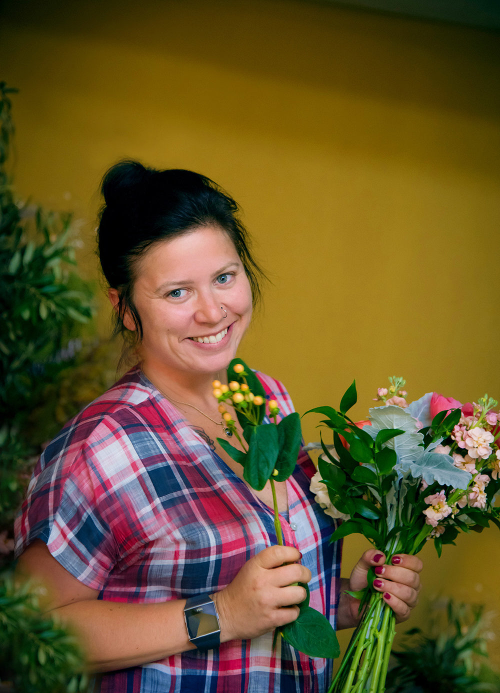 Amy Jo Goforth - Amy has been working in the floral industry for over 15 years.  After receiving a BFA in 2006, she is also a local artist and utilizes her knowledge to be a stronger designer.  Amy enjoys getting to know her clients to create a style unique to them and making their vision a reality.
