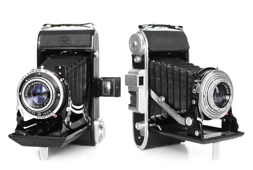 The Zeiss Ikon and Ansco Viking folding 6x9 cameras shown here are extremely fun to shoot. They both feature an f/4.5 lens and distance dial for focusing. These cameras can usually be found for less than $200.