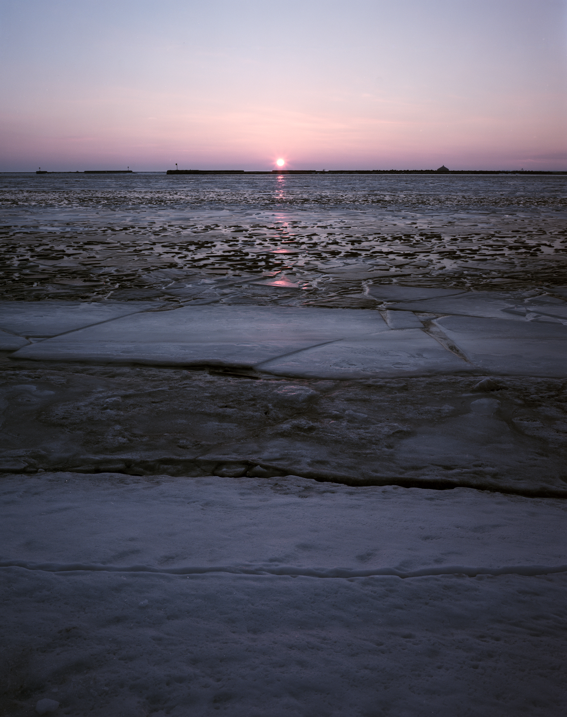 Sunset on frozen Lake Erie.