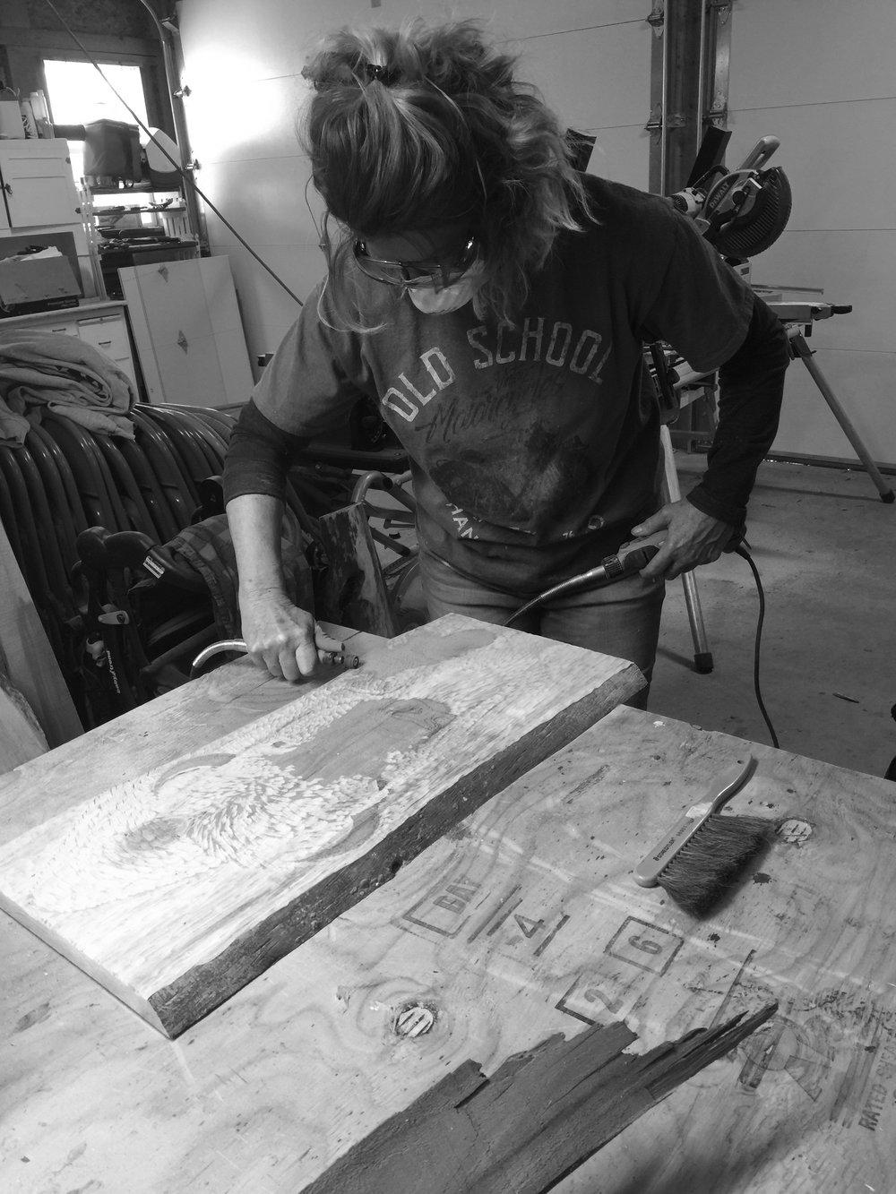 carving a buffalo -