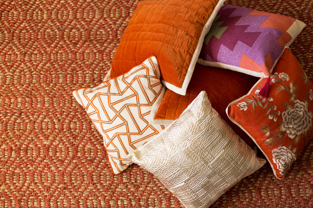 Dayka Robinson Budget Decorating pattern mix rust sisal pillows.jpg