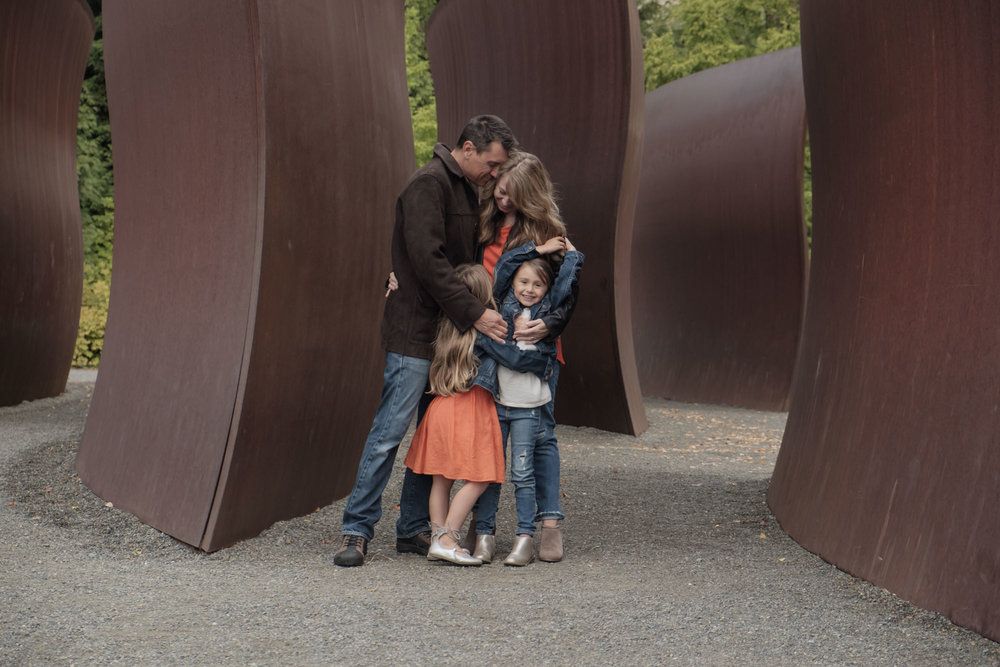 big family hug at the olympic sculpture park in seattle photography