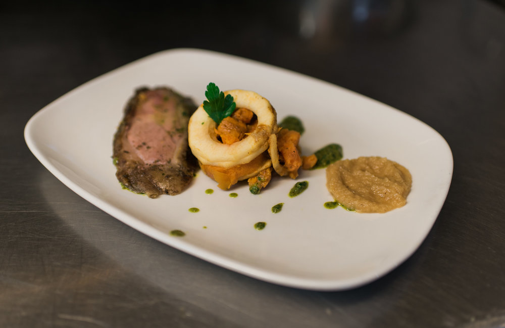 Smoked leg of lamb with mint chimichurri over mirliton puree and scalloped sweet potatoes.