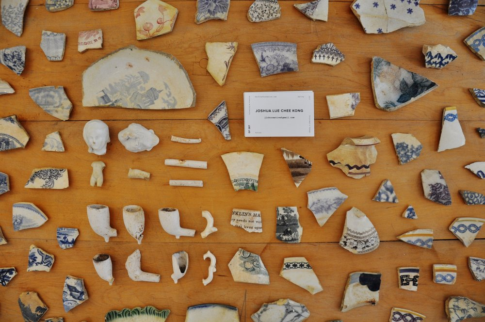 Selection of clay pipes, ceramic shards found in Trinidad and Tobago, Delfina Foundation, Victoria, London, 2017. Photo: Joshua Lue Chee Kong