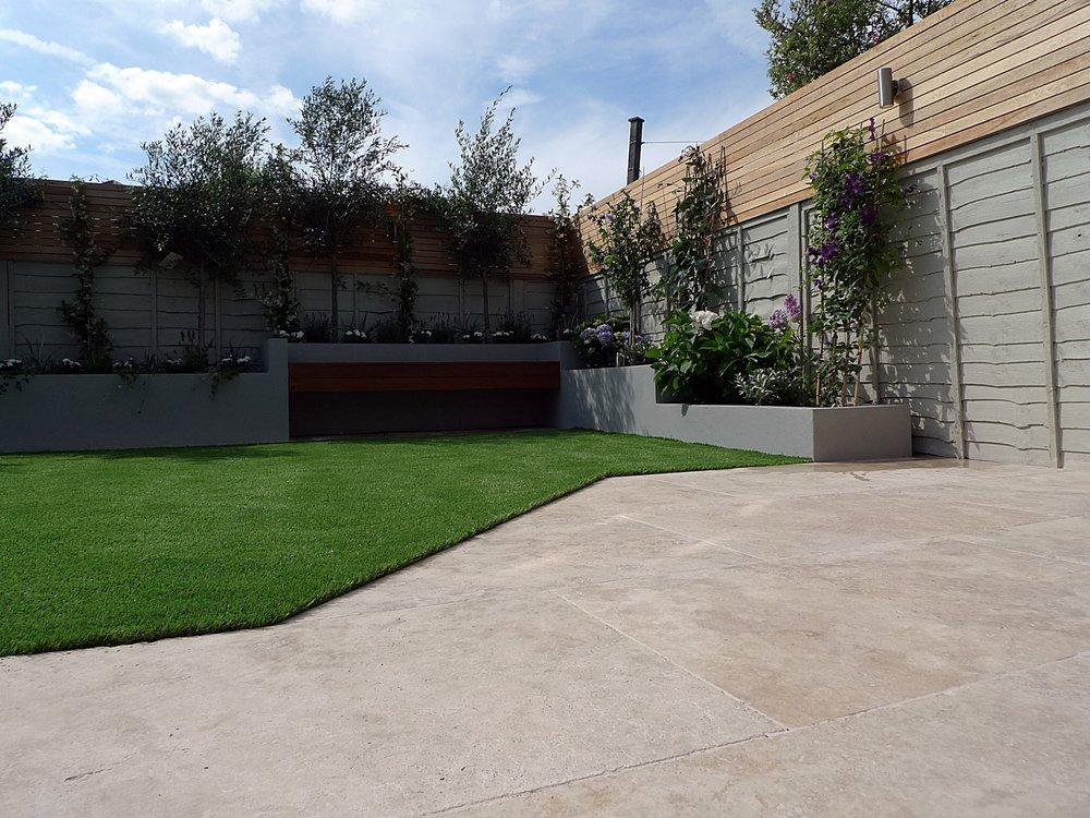 travertine-patio-paving-terrace-fake-easi-grass-floating-hardwood-bench-cedar-screen-trellis-fence-raised-beds-in-grey-dulwich-clapham-balham-battersea-fulham-chelsea-london.jpg