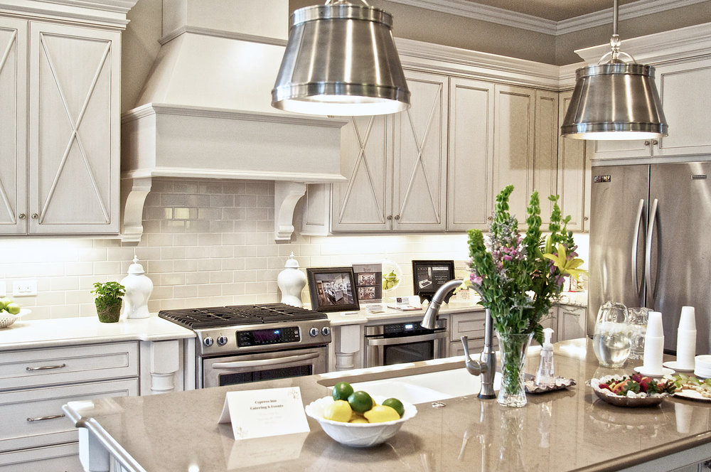 The cabinets are custom with a full overlay and the range hood has corbels