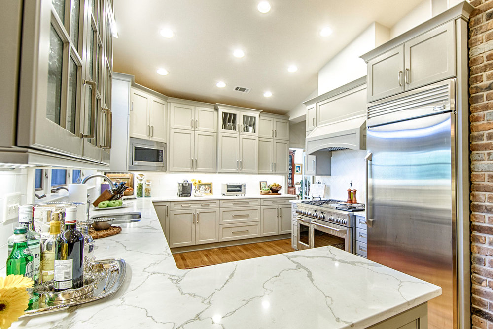 Polarstone marble look quartz countertops and GE Monogram appliances.