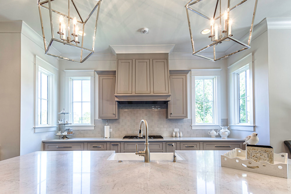 Countertops are nonporous quartz, Caesarstone 5000 London Gray.