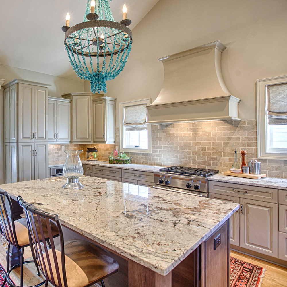 "The countertops are polished 3 centimeter Delicatus Granite and the backsplash is a 3"" X 6"" tumbled travertine."