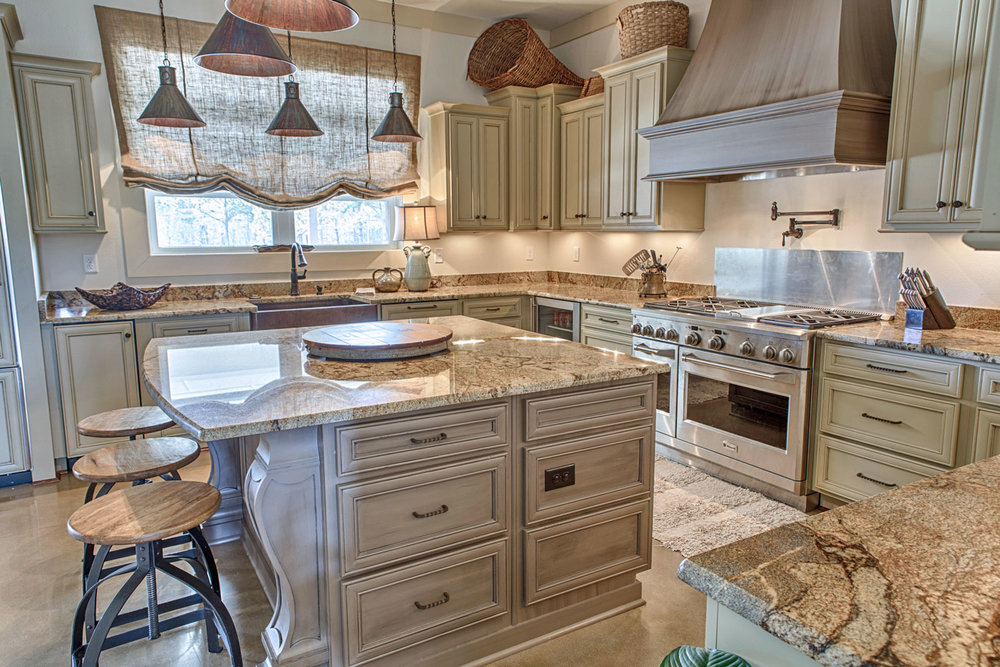 Upper cabinets are sized to have a staggered height and depth that provides greater interest.