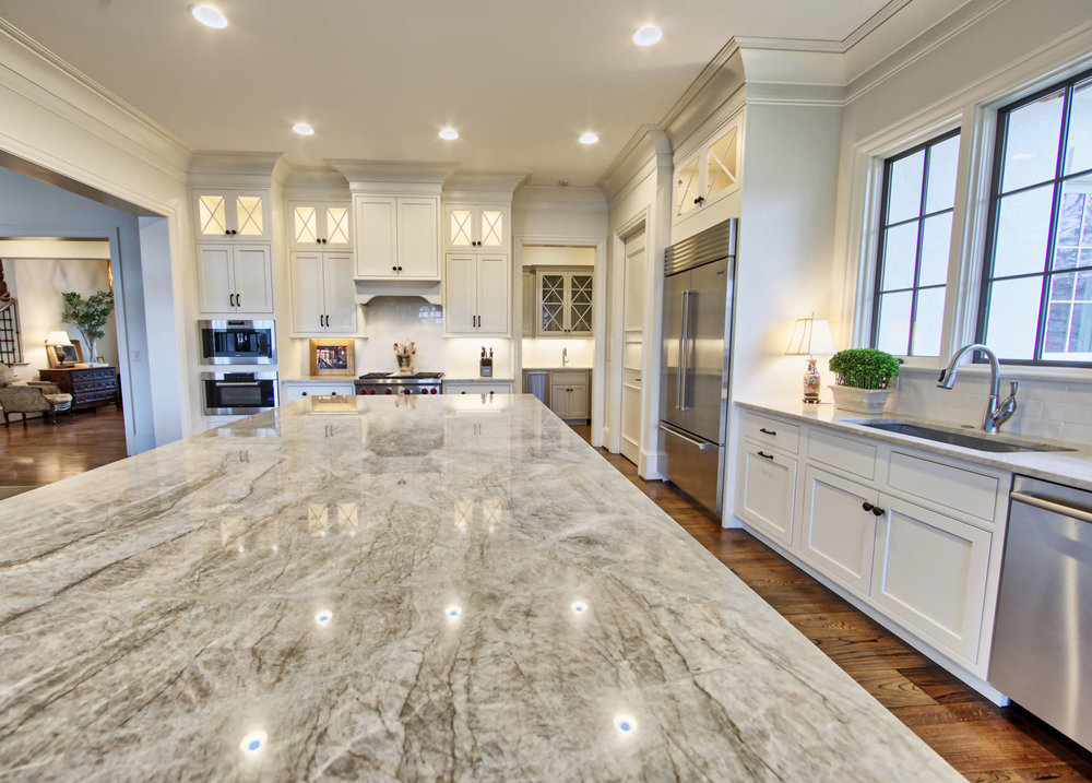 The island countertop is Taj Mahal quartzite