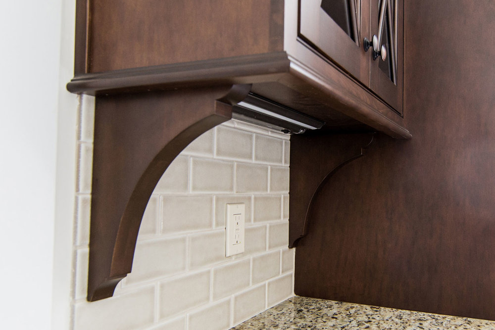 Kitchen design and historic renovation with cabinet corbels