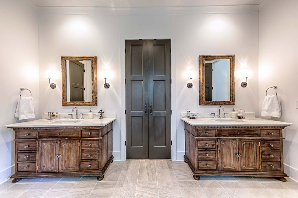 Montclair Danby Marble countertops on antiqued coffee color, St. James Restoration Hardware vanities.