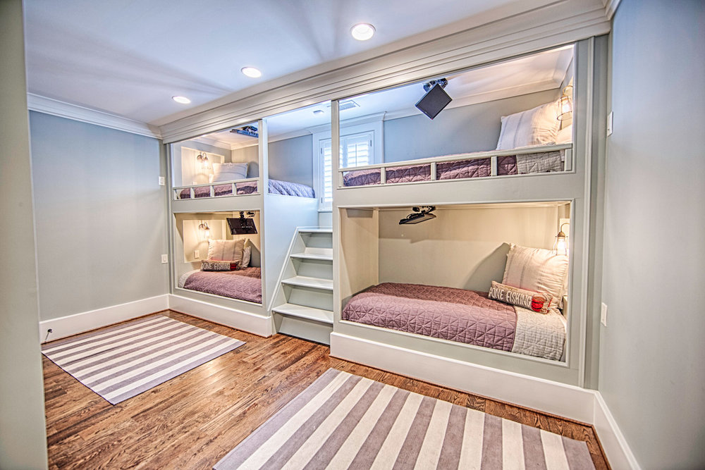 This custom designed set of four bunk beds contains video monitors, and individually controlled lighting fixtures for each unit.