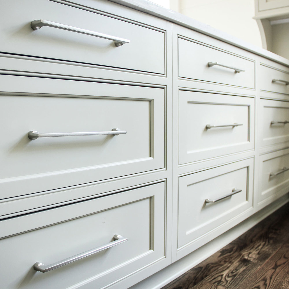 The kitchen cabinets are painted in Benjamin Moore Senora Gray 1530