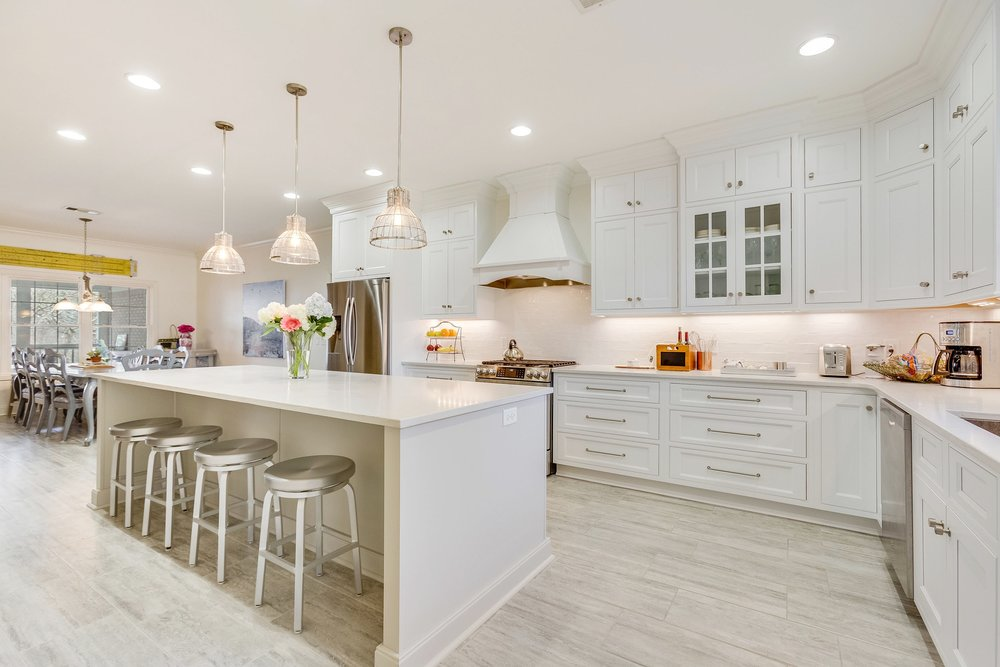 Open Concept Kitchen Design With GE Cafe Appliances, Arctic White Shiloh  Cabinetry, Zodiaq London